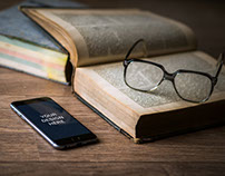 iPhone 6 with Book Mockup - Free PSD