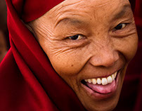 Laughing Nun of Boudhanath Stupa, Kathmandu, Nepal