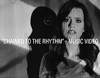 """Chained to the Rhythm"" 