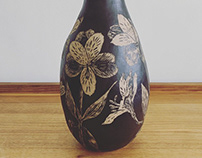Various sgraffito hand-carved foliage inspired pots