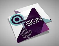 Brochure — @ sign