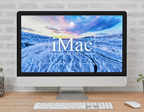Free iMac Placing on Wooden Table Mockup