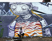 Large mural with a brush on a stick.