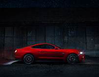 Ford Mustang around a stable