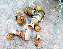 Flasks with leather cords and wooden beads