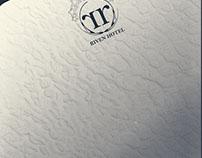 Logo for ;Riven Hotel