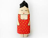 Papier mache sleeping girl figure in a red dress