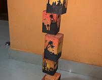 Watercolors on wooden sculpture