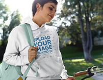 Girl on a Bike Wearing a Pullover Hoodie Template