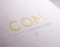 COM Comunicação - Logo