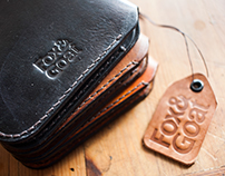 Upscale leather accessories brand.