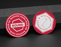 Round business cards mock-up on black paper background