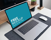 Free mockup: Macbook Pro with Office Supplies on the Ta