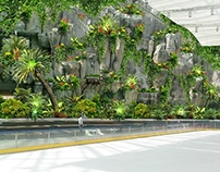 Huge rock wall with plants and advertisement tower