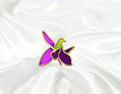 Khari-bulbul lapel pin