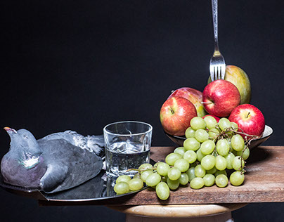Dead bird,fork fruit and a glass of water.