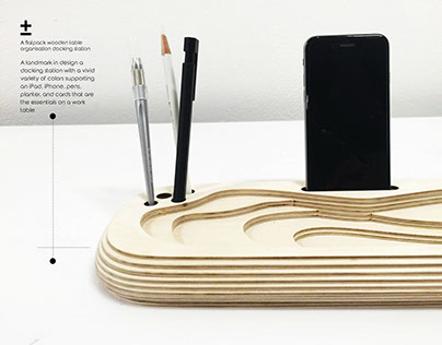+- / flatpack wooden docking station.
