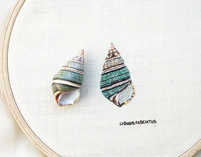 Embroidered sketch of a colorful snail