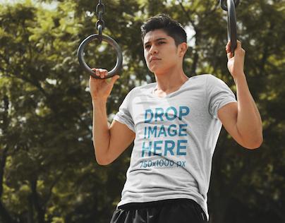 T-Shirt Mockup of a Man Exercising on Gymnastic Rings
