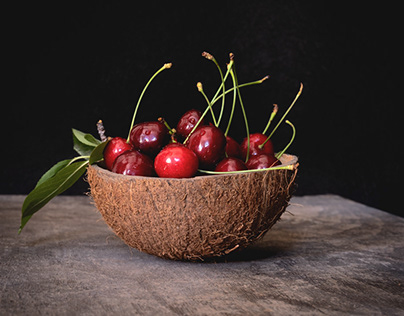 Fresh cherries in a coconut shell