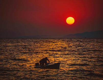 In the setting sun at sea