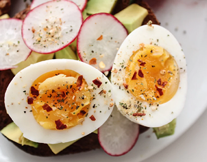 Hard-boiled eggs sprinkled with herbs and spices