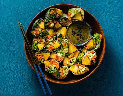 Vegan spring rolls of vegetables and peach.