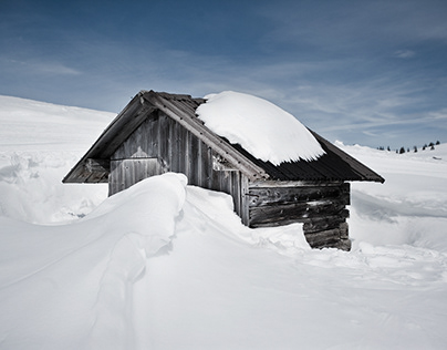 Snowbound shepherd huts in the Dolomites