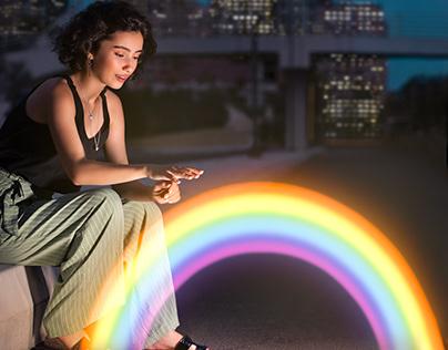 Woman touching the mini rainbow!