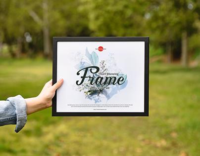 Free Girl Showing Frame Mockup PSD