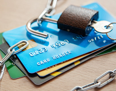 Credit Cards with an Open Lock and Chain.