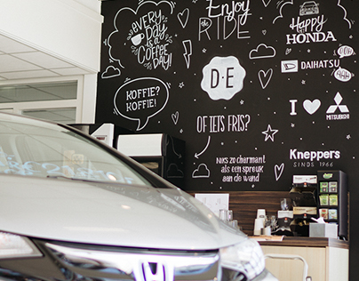 Chalkboard art in a car showroom