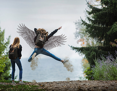 A woman flying by using her wings