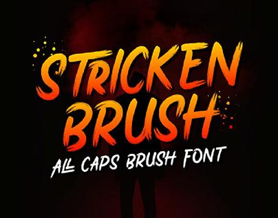 FREE   Stricken Brush all caps brush font