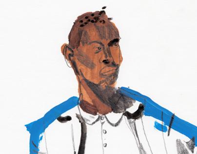 A MAN WEARING A BLUE COAT