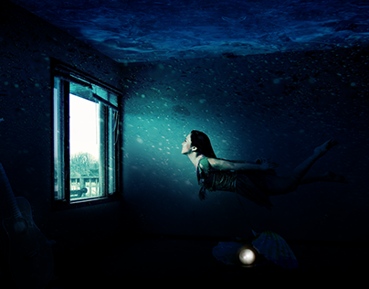 Girl underwater in her home