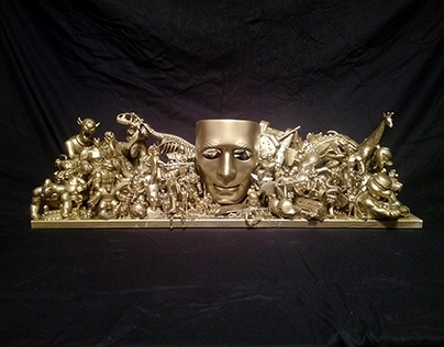 Gold mask sculpture