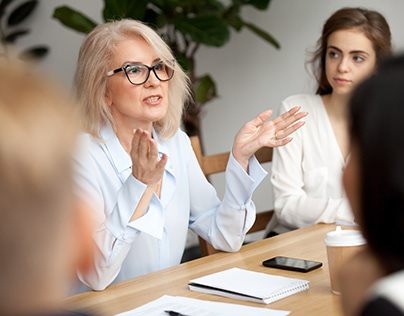 Businesswoman, Speaking to young Girl