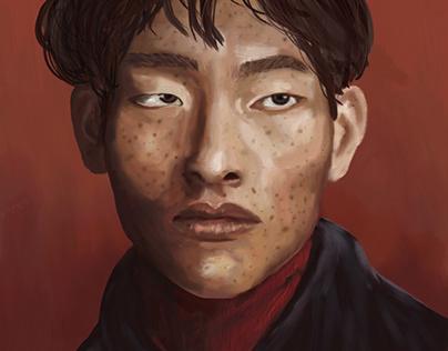 Portrait of a man in a dark red background
