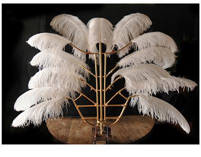 Triporteur à plumes