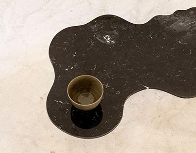 Lago low table. Liquid stone