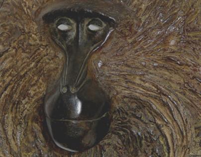 Masques bronze: Gélada et Mangabey