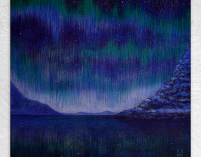 Northern Lights in snow-covered rocks
