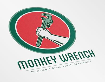 Monkey Wrench Plumbing Specialists Logo