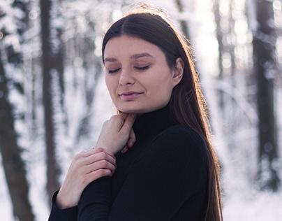 Winter photos - brunette girl in a black tight dress