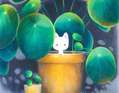 Tiny cat in a giant plant