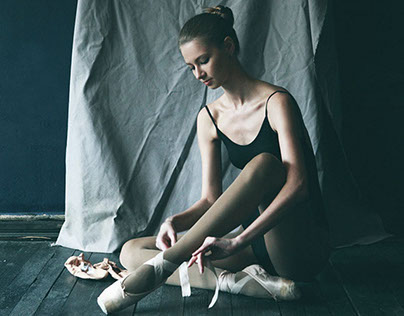 Girl with ballet shoes