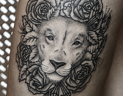 rosy lion tattoo