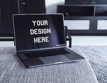 Free MacBook Pro Mockup on a Couch