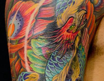 Phoenix rising from a skull full sleeve tattoo
